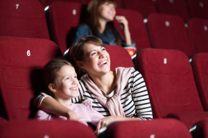 Woman watching movie with child