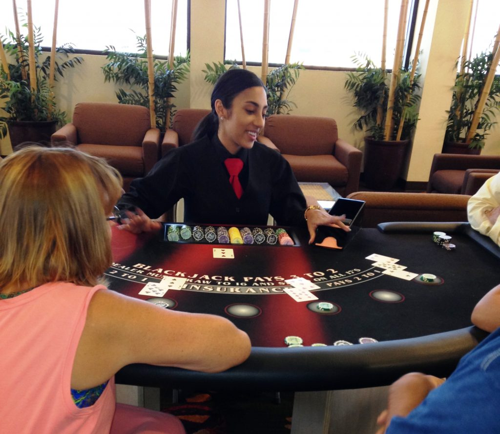 Friendly dealer Chelsea teaches our visitors the basics of `21' during our new weekly blackjack social.