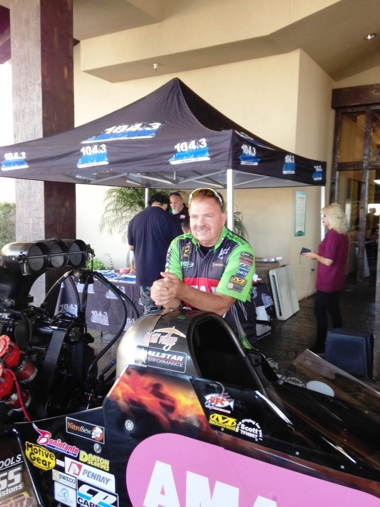 Terry McMillen poses next to his dragster during his Oct. 26, 2016 visit to Tahiti Village.