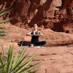 Woman in a yoga pose in the desert.