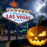 Carved pumpkin in front of the Welcome to Las Vegas sign.