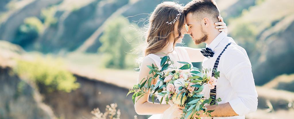 Couple enjoying an outdoor wedding.