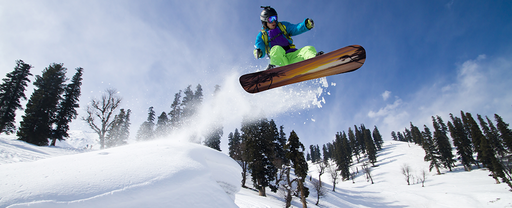 Man snowboarding at Lee Canyon during the winter.
