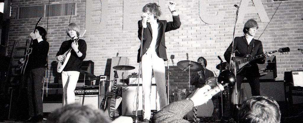 The Rolling Stones performing on stage.