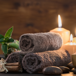Representation of a spa with towels and candles.
