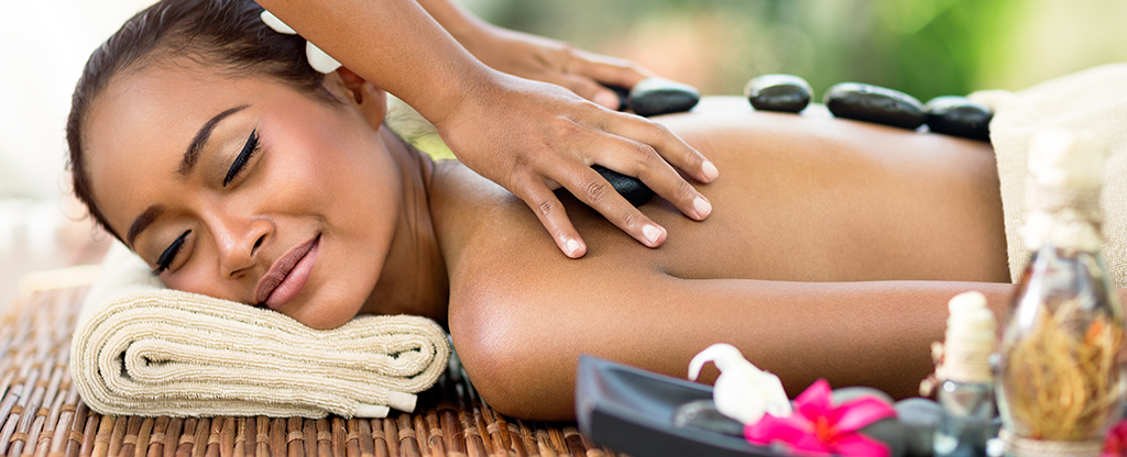 Woman getting a full body massage at the spa.