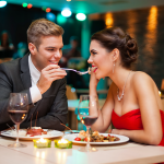 Couple enjoying a romantic meal together.