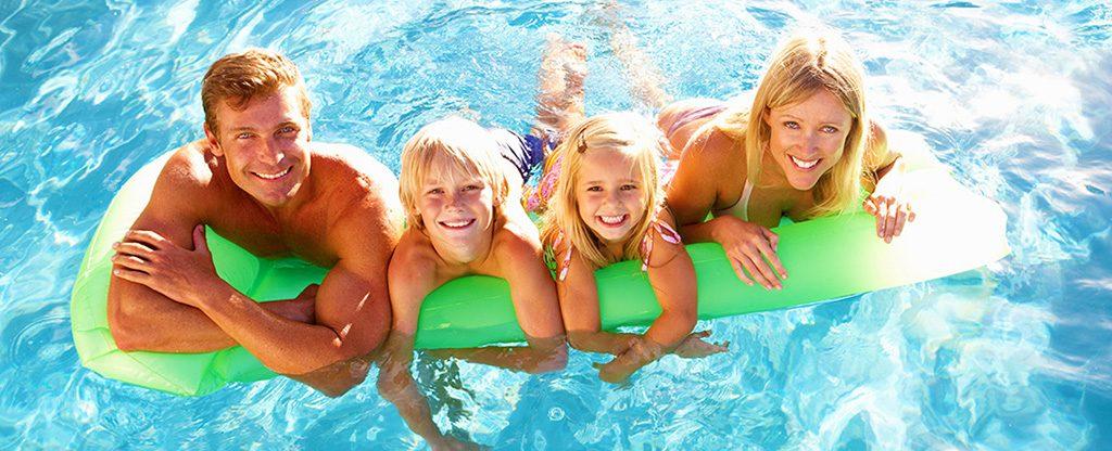 Family enjoying the Tahiti Village pool and lazy river.