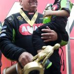 Top Fuel winner Terry McMillan holds his son Cameron after winning his first ever event title after 195 events Sunday October 29, 2017 at the NHRA Toyota Nationals at The Strip at Las Vegas Motor Speedway in Las Vegas, Nevada.  (Will Lester-Inland Valley Daily Bulletin/SCNG)