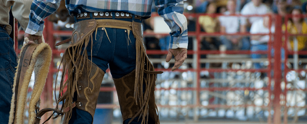 Cowboy standing in the rodeo arena.