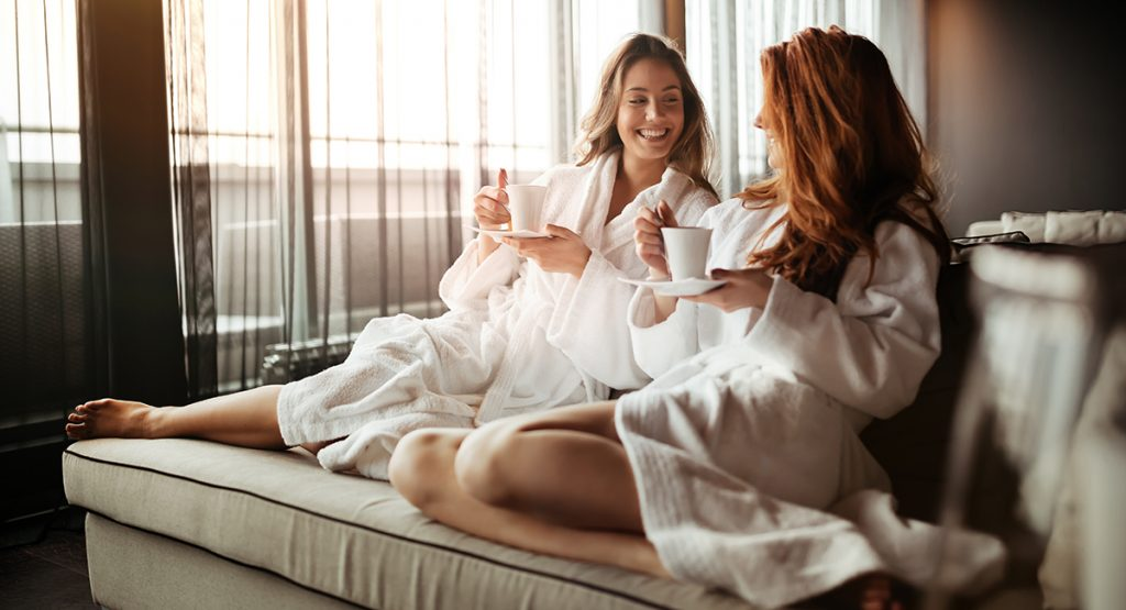 Woman relaxing in a spa drinking tea