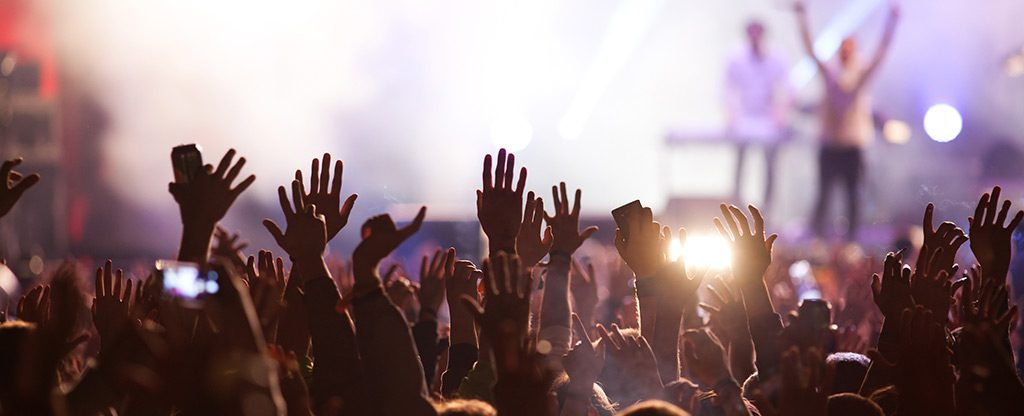 Large crowd enjoying a concert.
