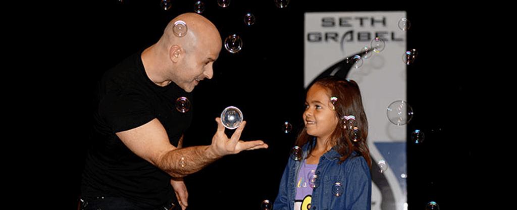 Seth Grabel performing a magic show at Tahiti Village in Las Vegas.