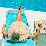 Woman at Vegas swimming pool with pina colada cocktail.