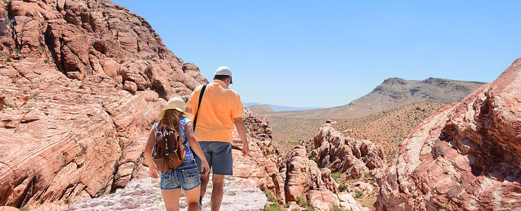 Father and daughter hiking in Red Rock Canyon in Nevada.